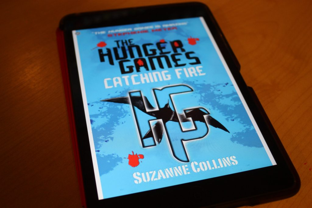 Catching Fire by Suzanne Collins (Hunger Games #2)