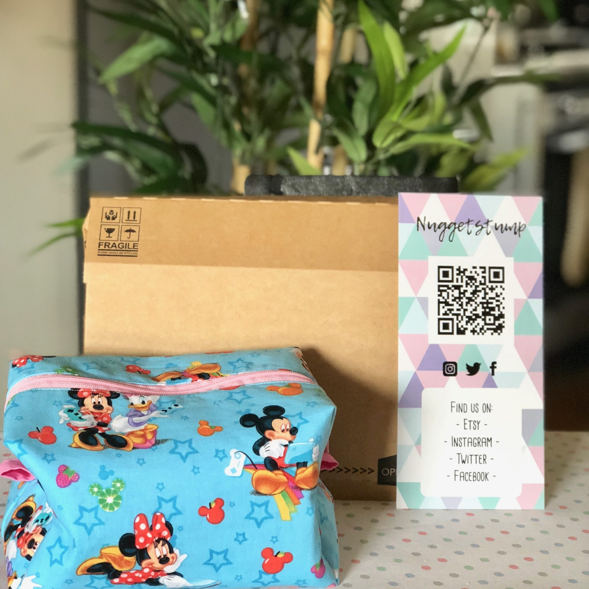 Lil Packaging Review - an image of a handmade bag, next to a cardboard mailer