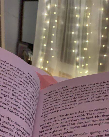 An open book with fairy lights behind
