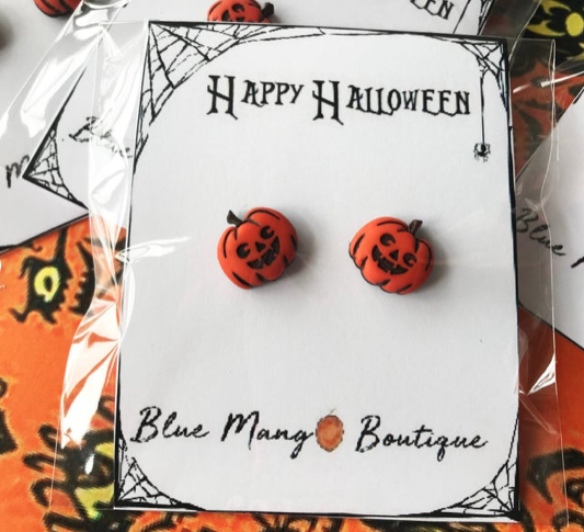 Cute halloween pumpkin earring studs on a backing card