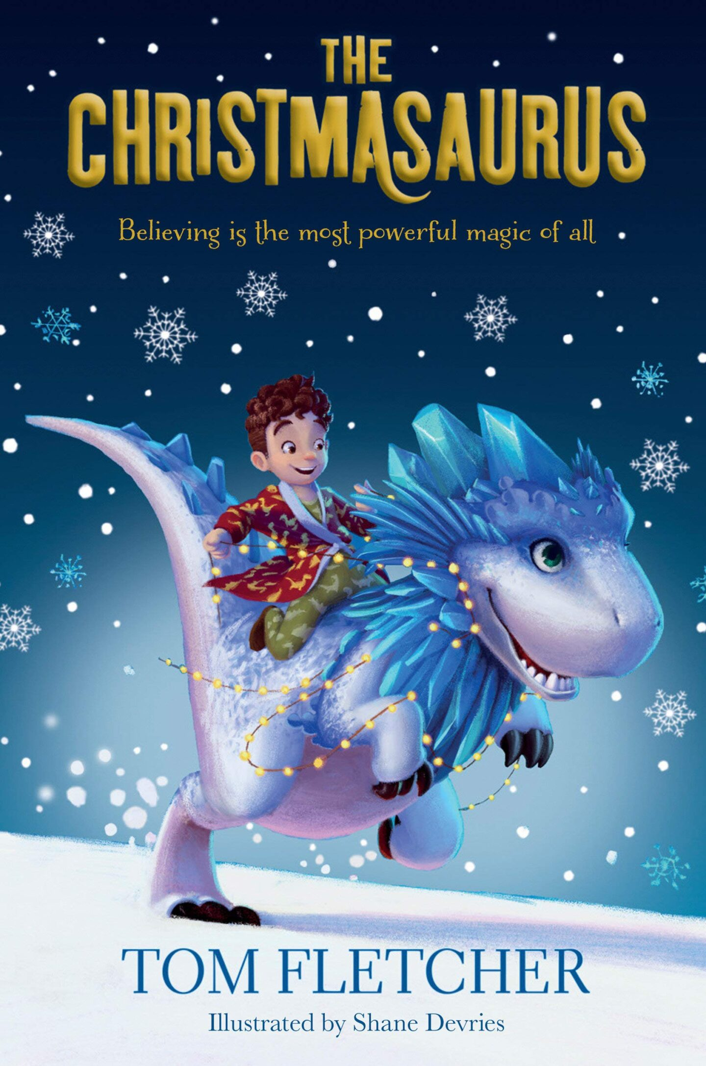 Book cover for The Christmausaurus which features a boy riding a dinosaur