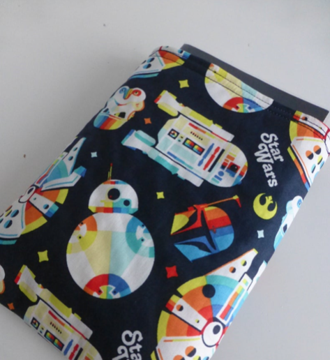 Star Wars themed book sleeve with colourful R2-D2s, Millennium Falcons and BB8s